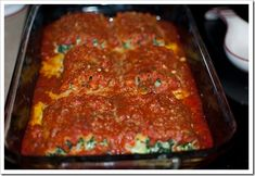 Spinach & Mozzarella Lasagna Roll-Ups  1 bag frozen spinach, thawed  2 cups shredded mozzarella  2 eggs  1 tbsp. grated parmesan  1/2 tsp. salt  1/2 tsp. pepper  6 Lasagna noodles  Spaghetti Sauce {I used Classico, Spicy Tomato & Basil}   Preheat oven to 350.  Boil 6 lasagna noodles until al dente.  While your noodles are on the stovetop, mix together spinach, cheeses, eggs, salt, & pepper until well blended.