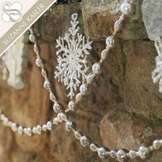 Jewelry for your tree, mantel or chandelier. This shimmering mercury glass garland designed by Suzanne Kasler has all the romantic vintage look of antique silver.