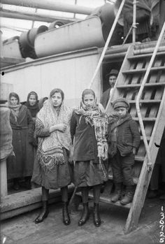 """1/7/1920-New York, NY-Left to right- Linda Scholl, Flielina Scholi and Vincent Ianlani were among the little immigrants arriving in New York from Italy today on the S.S. Regina de Italia. They lived in the same town in Italy and now that they have arrived in their """"promised land,"""" they will seperate, their parents going to different cities in the country."""