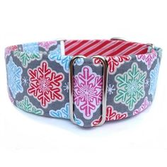 A bright and festive martingale dog collar featuring candy colored snowflakes coordinated with red and white peppermint stripes. For medium to large dogs.