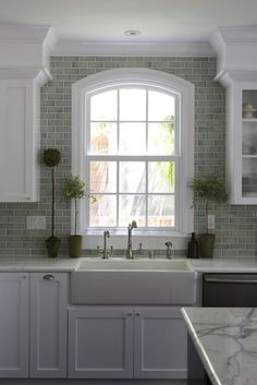 Extending the backsplash up the entire wall. I love this - so simple but completes the room