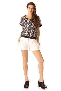 Blusa stretch en encaje bicolor con puños y pretina combinados