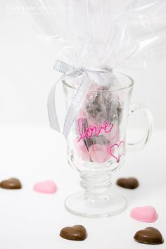 """Valentines DIY Gift -   Melting and making chocolate molds is so fast and easy, but adds such a personal touch and extra fun to Valentine's Day giving.  I love using paint pens because they are so quick and easy.  On the mug I made, I simply wrote the word """"love"""" and drew a heart."""
