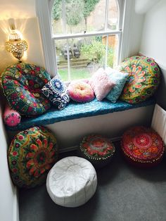A lovely way to update a window seat. Add round cushions and bold Moroccan prints to create a bold yet comfortable space.