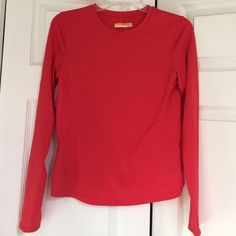 Lucy workout shirt NWOT Lucy Tech workout/active top, w/ thumb hole. Red/burnt orange in color, nylon/spandex fabric. Lucy Tops Tees - Long Sleeve