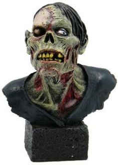 "Zombie Bust 6 1/4"". A zombie bust made from cold cast resin and hand painted to show all the gory detail. 6 1/4"" x 2 1/2"" x 2 1/4"""