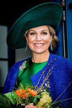 Dutch Queen Maxima wore a brilliant satin frock, which she accessorized with a glittering butterfly broach and pair of drop emerald and diamond earrings, opens the bio Fair in Zwolle, Netherlands.