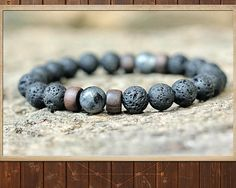 ■■■■■■■■■■■■■■■■■■■■■■■■ Mala OVERVIEW  This is one of my designer Yoga mala bracelets: A time-tested healing tool designed to help humans easily restore holistic balance.  Its complete with gemstone mineral & metaphysical infocards, a user guide and an infographic on its ecological footprint.  This artisan mala bracelet features:  ✔ A-grade genuine Lava Stone and Larvikite (Black Moonstone) [8mm] ✔ Upcycled exotic hardwood spacers ✔ Professional-grade easy-to-wear stretchy cord  ▸ LAVA S...