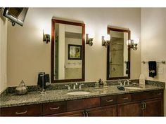 Master bathroom with dual sinks and mirrors