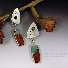 """This is an unusual and hard-to-find stone. Its Chrysocolla & Cuprite. The cuprite is a relative of copper and gives it the red color. The tops are hand-crafted hollow-forms from sterling silver. The posts are 14k white gold for sturdiness. 2.25"""" length x .625"""" width x .25 depth"""
