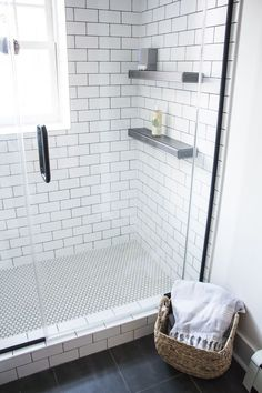 Love the mix of tile in this trendy black and white bathroom