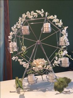 Ferris Wheel Cupcake Holder Wedding Centerpiece.  using battery operated tea lights, crepe paper roll
