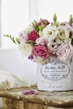 FRENCH COUNTRY COTTAGE: Old tobacco tin vase. Perfect Shabby Chic centerpiece #BHGREParty