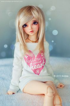 This doll is beautiful. She is owned and her faceup was done by ***Andreja***, via Flickr