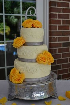 3 tier lace with yellow roses wedding cake    cakemydayorders@yahoo.com