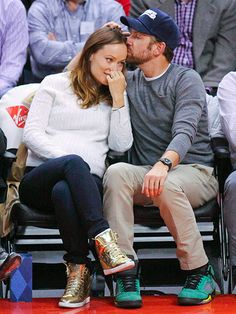 Star Tracks: Wednesday, February 19, 2014 | IT'S IN HIS KISS | 1, 2, 3 … aww! Jason Sudeikis sneaks in a quick smooch for expectant fiancée Olivia Wilde on Tuesday night at L.A.'s Staples Center, where the Los Angeles Clippers fell to the San Antonio Spurs, 113-103.
