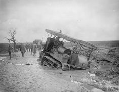 WW1, Oct 1916, Somme; Hold Caterpillar Tractor sunk in the mud on the Guillemont-Martinpuich road. © IWM