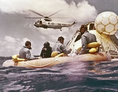 Sitting in the life raft, during the Apollo 12 Pacific recovery, are the three mission astronauts; Alan L. Bean, pilot of the Lunar Module (LM), Intrepid; Richard Gordon, pilot of the Command Module (CM), Yankee Clipper; and Spacecraft Commander Charles Conrad. The second manned lunar landing mission, Apollo 12 launched from launch pad 39-A at Kennedy Space Center in Florida on November 14, 1969 via a Saturn V launch vehicle.  (Image: