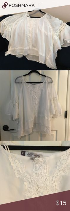 NEW white sheet Jennifer Lopez blouse, size L NEW never worn white sheer cape-like blouse. Jennifer Lopez brand, size L. Super cute. Jennifer Lopez Tops Blouses