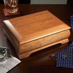Keep treasured mementos in this handsome wooden box  Our solid wood keepsake box conveys your congratulatory message and keeps treasured mementos. We can engrave quotations, personal messages, a monogram or a logo inside and out on the lid of this sturdy wooden box. It also makes an attractive jewelry box.