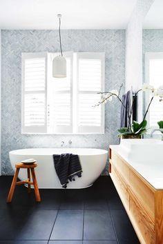 Stunning herringbone tiles in this bathroom designed by Deanne Jolly.