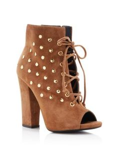 Italian icon Giuseppe Zanotti crafts rich suede booties daintily dotted with gold-tone studs, cinched with on-trend lace-up closure, and finished with flirty peep toes. | Suede upper, leather lining,