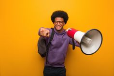 Young African American Man Holdinga A Megaphone Cheerful And Smiling Pointing To Front American Man, African American Men, Free Photos, Social Media Marketing, Cheer, Photoshop, Smile, Guys, Small Businesses