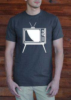 Remember tinkering with your antenna of your old TV! Get this classic vintage TV on your tee today! Throw this shirt on and walk out the door