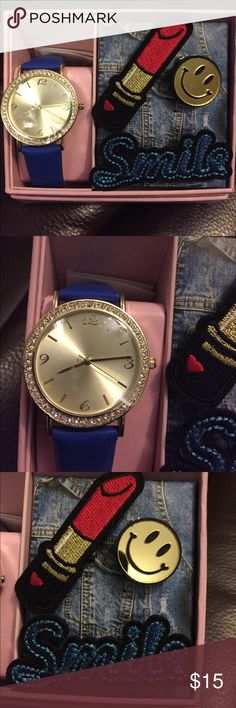 Watch set NWT pretty Blue band with diver face and faux diamonds around it. Comes with a lipstick, smiley face and the word Smile pens that you can put on any clothing or backpack. Accessories Watches