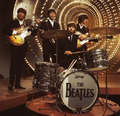 The Beatles perform 'Rain' and 'Paperback Writer' on BBC TV show 'Top Of The Pops' in London on 16th June 1966. Left to right; John Lennon (1940-1980), Paul McCartney, Ringo Starr and George Harrison (1943-2001). (Photo by Mark and Colleen Hayward/Redferns)