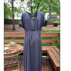 Pewter plus size gorgeous dress! This short sleeve maxi dress features a plunging neckline and an empire cut silhouette. Dresses