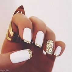 Gold Tips on White Background Nails.