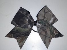Hey, I found this really awesome Etsy listing at https://www.etsy.com/listing/124091936/mossy-oak-camo-cheer-bow