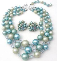 """Vintage Rockabilly Beaded Jewelry Necklaces - This is a triple strand of lucite & glass beads with matching earrings in shades of blue and light green. The shortest strand of the necklace is 18"""" long,"""