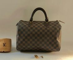 Louis Vuitton Brown Damier Ebene Canvas & Leather Speedy 30 Satchel. Save 65% on the Louis Vuitton Brown Damier Ebene Canvas & Leather Speedy 30 Satchel! This satchel is a top 10 member favorite on Tradesy. See how much you can save