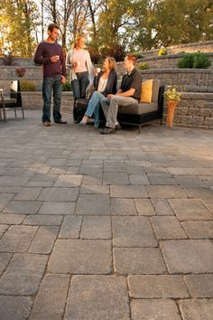 Barkman's Roman pavers in Sierra Grey act as the structural base for the huge patio outlined by a row of Desert Buff 8x4 Roman pavers.