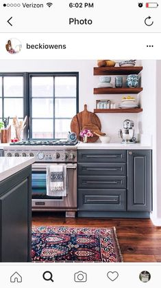 Open shelving with polish pottery, kilim rug, blue white white counter cabinets...