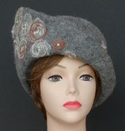 """""""EDITH""""…… A bit """"Downton Abbey-ish"""".  A cloche with attitude.  100% alpaca fabric with wool/ alpaca/ linen swirls needlefelted into the fabric prior to construction of the hat.  Makes a statement … and a nice one at that!"""
