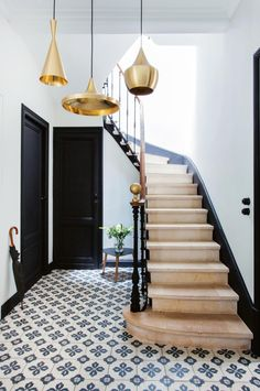 french-staircase-gold-pendant-lights-tile-floor