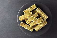 Oaty Ginger Crunch from Our Kitchen at Fisher & Paykel. In this recipe the base of the slice is cooked to golden perfection before being drowned in that super delicious almost fudge like icing that only a ginger crunch lover knows.The recipe (and the tin size) can easily be halved, but it's darn good so rest assured if you are a ginger lover, it won't last.