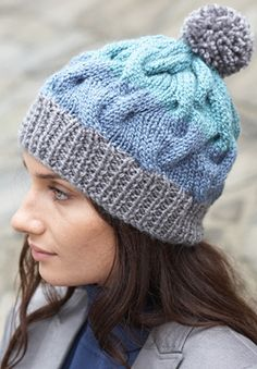 No need for circular or double-pointed needles as you knit this tri-colored hat flat and seam it up the back. Shown in Patons Classic Wool. (Free knitting pattern)