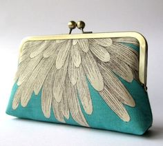 Turquoise and grey feather print clutch.