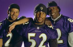 Baltimore Ravens Rod Woodson, Ray Lewis (52) and Shannon Sharpe on Nov. 2, 2000, in Baltimore, Md. The trio was at the center of the team's Super Bowl run. (Doug Kapustin for Sporting News)