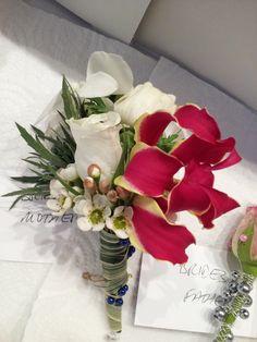 Corsage (gloriosa, rose, waxflower, china grass)