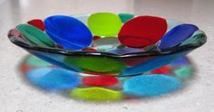 Fused Glass Bowl with Circles in Blues, Greens and Red. by marjoramhotglass on Etsy https://www.etsy.com/listing/162943852/fused-glass-bowl-with-circles-in-blues