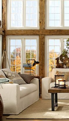 .Love the details of this room especially the reclaimed timbers against the crisp whit trim.