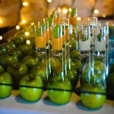 What a cool idea. Big thing is the safety with the glass. If drunk guests will pull apples out, how to stay on top of it. You could cover pretty blah tables and it would be cool. Guess you could use cheap fluorescent plastic as well; maybe underneath lighting. food display on glass w/ apples or something else (about Brazil) under the glass table
