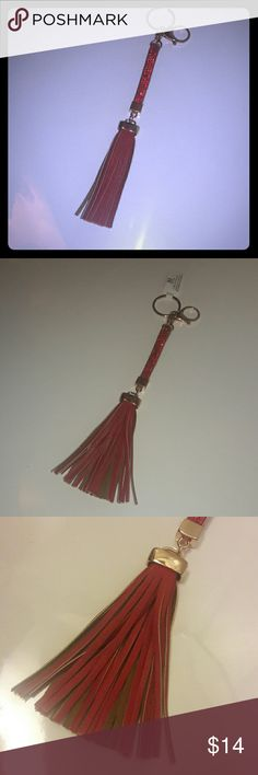 XL Tassel Charm with rhinestones Adorable red faux leather tassels with gold accents...  red rhinestones at the top... with a keyring and lobster clasp... perfect accessory for hanging on your purse, keys, your favorite distressed jeans... any questions please feel free to ask!!... the possibilities are endless for this cute piece :)...please feel free to bundle  <3 Accessories