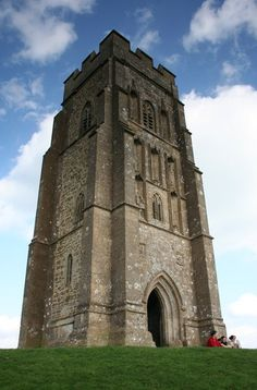 Glastonbury Tor is a conical hill in Glastonbury, England, which is topped by a 14th-century church tower. Rich in legend and mythological associations, Glastonbury Tor may have been a place of ancient ritual and it was certainly a place of pilgrimage for Catholics in medieval times.