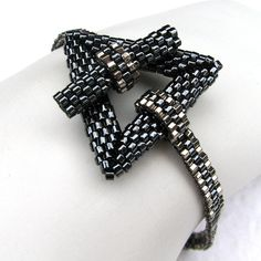love the band Heavy Metal Simplicity A Beadwoven Bracelet 2420 by SandFibers Beaded Jewelry, Handmade Jewelry, Beaded Bracelets, Jewellery, Peyote Triangle, Simple Bracelets, Peyote Beading, Bijoux Diy, Beading Projects